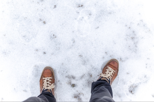 Human step on frosted ground